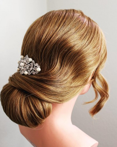 Low Chignon with a Slight Finger Wave