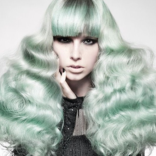Voluminous Green Hair with Bangs