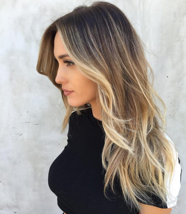 Messy Dark Brown Locks with Blonde Streaks