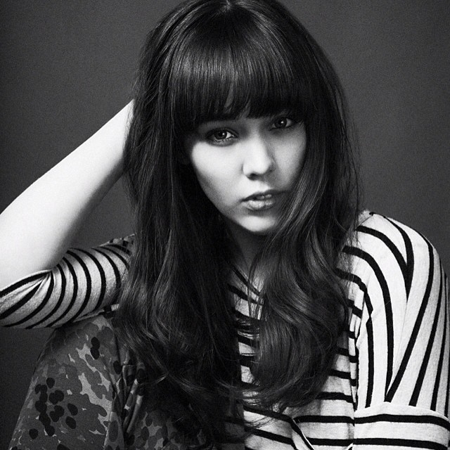 Fashionable Mid Length Brunette Strands with a Fringe