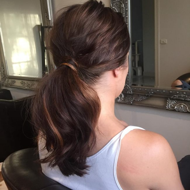 Wavy Brunette Bangs with a Messy Ponytail