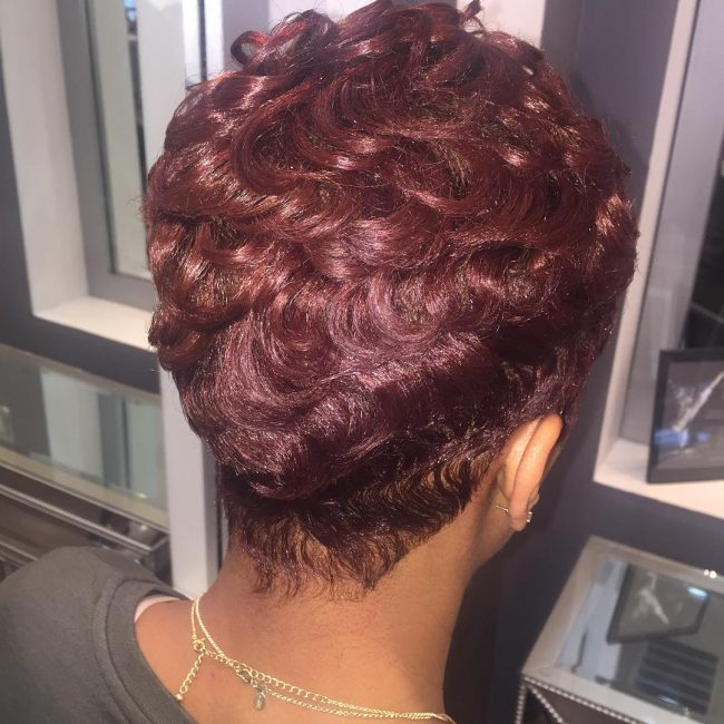 Wavy and Layered Burgundy Pixie Haircut